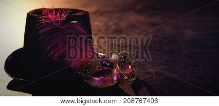 Masquerade masks and hat on stage