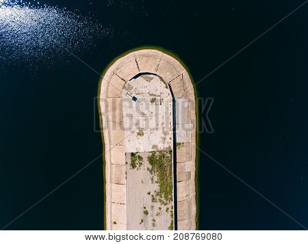 Aerial view breakwater at sea, cutwater, pier, groyne mole