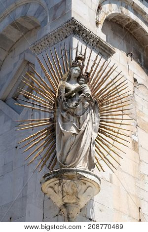 LUCCA, ITALY - JUNE 03: Virgin Mary sculpture with Jesus on the corner of the facade of the San Michele in Foro Church in Lucca, Italy, on June 03, 2017.