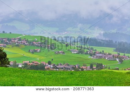 Aerial View on Obermaiselstein in the Fog. Oberallgau Germany