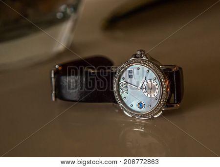 men's luxury wrist watch on a dark background. still life. selective focus.