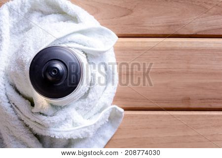 Top View White Cloth And Plastic Water Bottle On Wooden Table