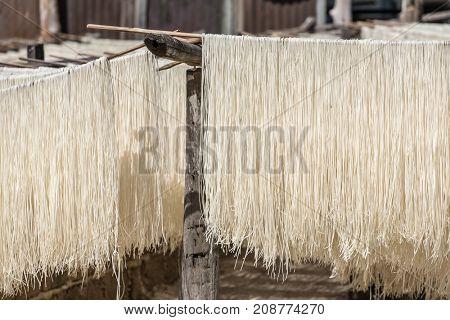Homemade rice pasta drying on sun in Myanmar.