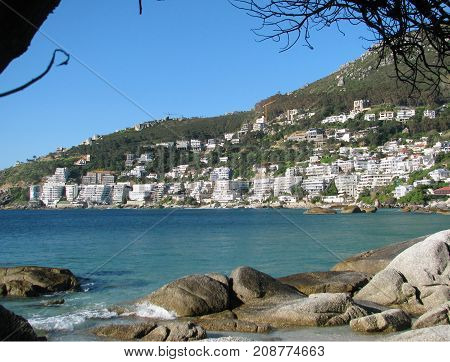 FROM CLIFTON, CAPE TOWN, SOUTH AFRICA, WITH CALM, TURQUOISE WATER AND A CLEAR SKY