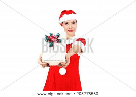 Christmas concept : Beautiful Asian woman in Santa Claus clothes and hat giving Christmas gift isolated on white background