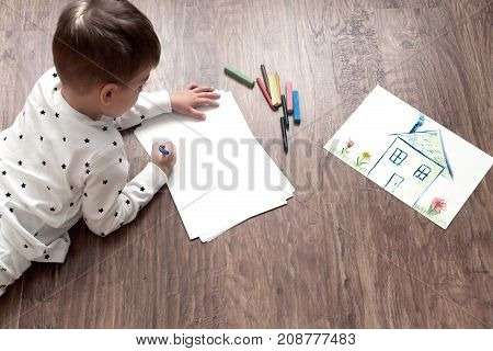 Cute Child Draw With Colorful Crayons
