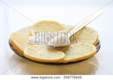 Appetizing Lemon With Slices And Sugar, A Teaspoon