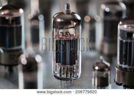 Various radio tubes on a metal surface