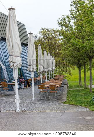 tables and chairs outside a cafe in a holiday hot spot, al-fresco dining