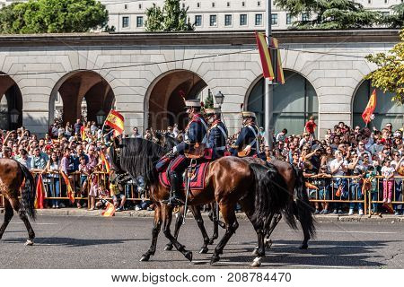 Madrid Spain - October 12 2017: Calvary marching in Spanish National Day Army Parade. Several troops take part in the army parade for Spain's National Day.