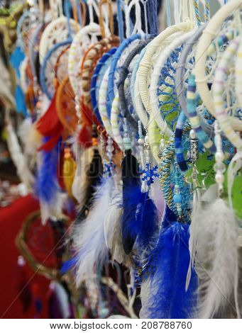 Photo of handmade dreamcatchers with feathers and beads