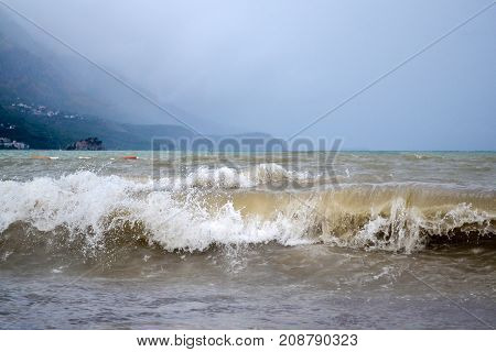 Powerful waves on the Adriatic coast. Dirty wave. Dark sky. The storm is approaching