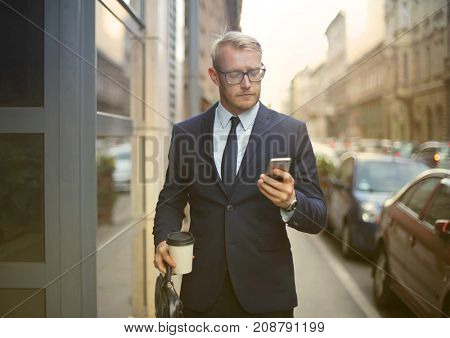 Manager checking his phone