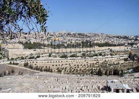 A wide-angle view of the temple district of Jerusalem with the church of the Holy Sepulchre the city walls and the golden the dome of the rock