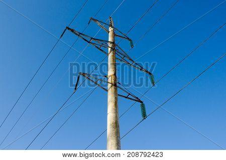 High voltage line on blue sky background