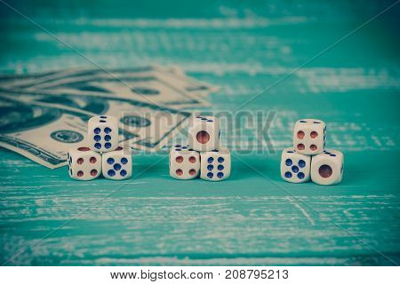 Dice With Bank Note On Color Table