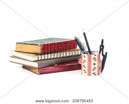 Pen And Education Tool In Can And Old Book