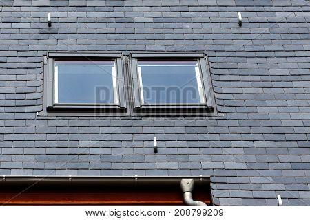Roof of black slate tiles and skylights Windows