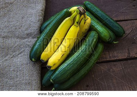 not every cucumber is banana, not every banana is cucumber, while banana and cucumbers stand side by side.