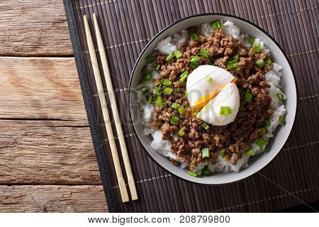 Japanese Spicy Beef Soboro With Egg Benedict, Rice And Green Onion Close-up. Horizontal Top View