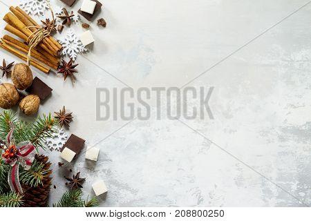 Ingredients For Christmas Baking - Chocolate, Spices, Sugar And Nuts On Stone Or Slate. Seasonal, Fo