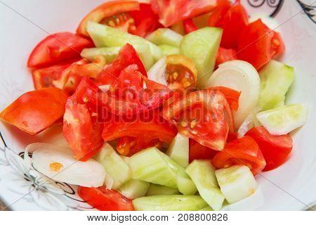 Tomato cucumber salad inside the trough Azerbaijani salad