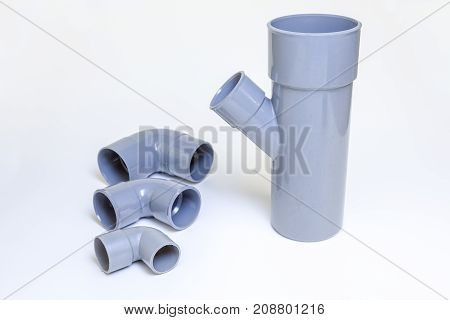 On a white background there is a bend of a drain in PVC