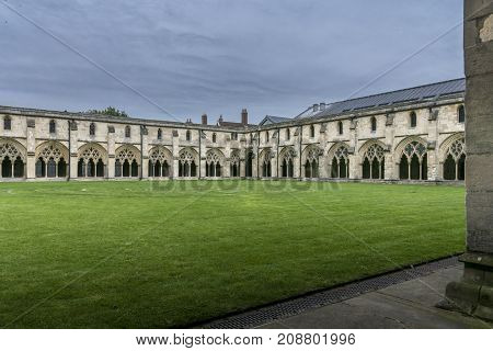 The cloisters and garden at Norwich Cathedral Norfolk UK