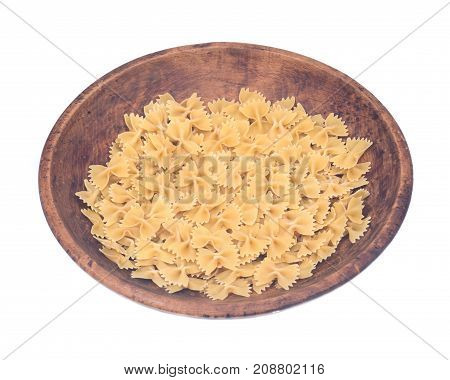 Farfalle durum semolina pasta in wooden bowl isolated on white background