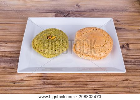 Cookies With Pistachio On White Plate