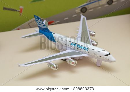 White airplane toys in the background without focus