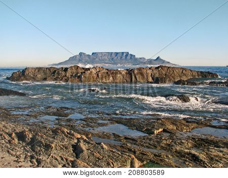 BLOUBERG STRAND, WITH HUGE BOULDERS IN THE FORE GROUND, AND TABLE MOUNTAIN IN THE BACK GROUND 01c