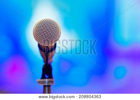 Close up microphone in press conference event or lecture room with blur background