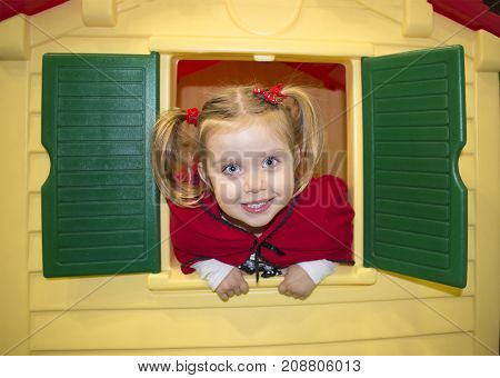 Cute blonde little girl wearing Red Riding Hood costume