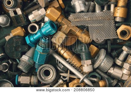 Industrial photo. Old vintage rusty and metal fittings iron and steel screw. Bolts hardware collection background. Assorted collection of used nuts and bolts