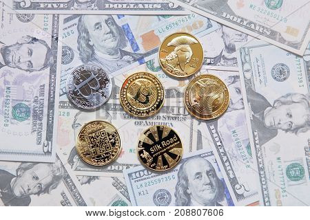 Tokens symbols of bitcoins on the background of paper money.