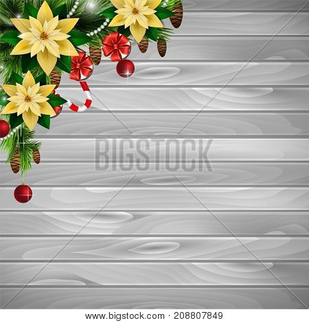 Christmas corner decoration with evergreen treess gift boxes and poinsettia with two cendy canes on wooden background