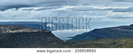 Travel to Iceland. beautiful cloudy sky over fjord in the north-west of Iceland, on the Westfirdir peninsula in Iceland.
