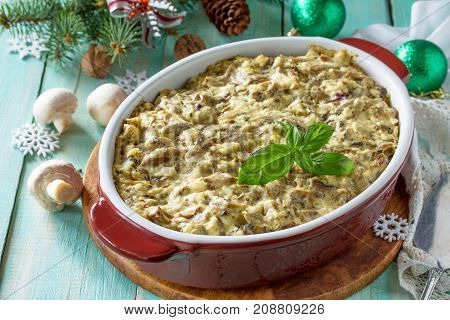 Baked Potatoes With Mushrooms And Cheese On A Wooden Kitchen Table.