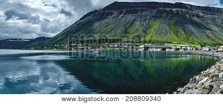 Travel to Iceland. beautiful cloudy sky over fjord and Flateyri, a village in the north-west of Iceland, on the Westfirdir peninsula in Iceland.