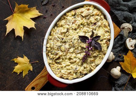 Baked Potatoes With Mushrooms And Cheese On A Brown Stone Or Slate Background. Top View.