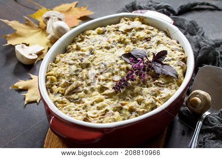 Baked Potatoes With Mushrooms, Sour Cream And Cheese On A Brown Stone Or Slate Background.