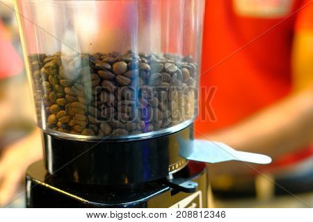 coffee beans in a bowl in market.