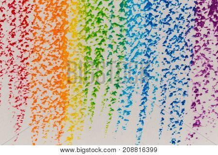 Wax crayon hand drawing rainbow for background