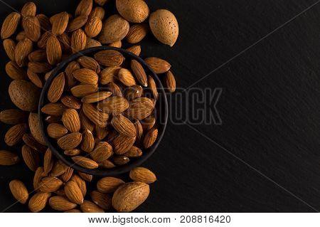 Almonds On A Dark Background