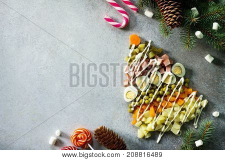 Christmas Tree Made From Salad Olivier On A Gray Slate, Stone Or Metal Background. Beautiful Christm