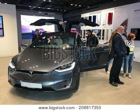 Stuttgart, Germany - October 14, 2017: People are examining the Tesla Model X in the showroom in Stuttgart, Germany.