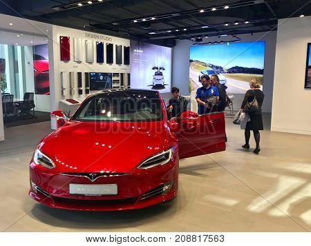 Stuttgart, Germany - October 14, 2017: People are examining the Tesla Model S in the showroom in Stuttgart, Germany.