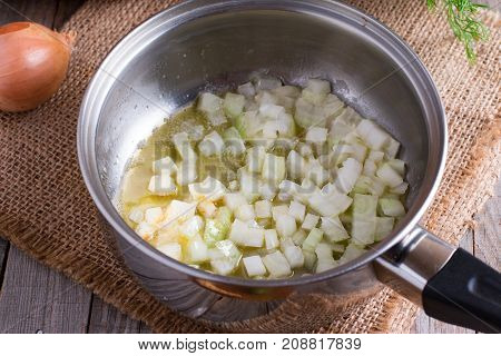 White onion finely chopped and poured into a pan