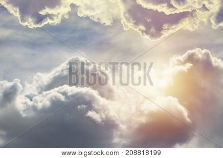 Blue sky clouds and sun light background.Toning